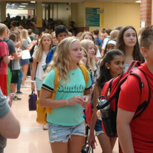 Photo of students entering a middle school